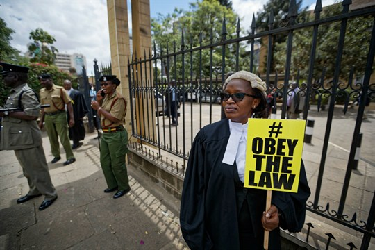 Mercy Wambua, the CEO of the Law Society of Kenya, protesting outside the Kenyan Supreme Court.