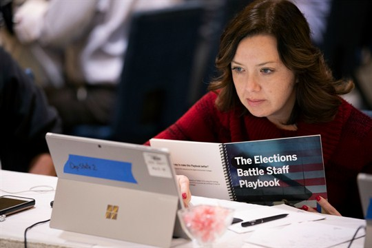An election official works during an exercise to simulate different scenarios for the 2020 elections