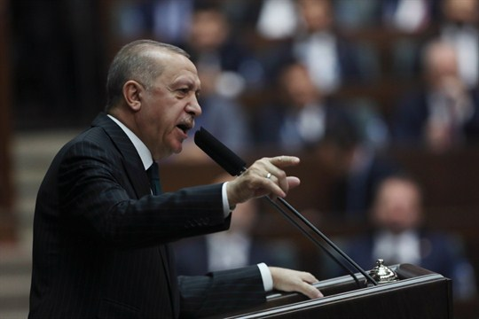 Turkish President Recep Tayyip Erdogan addresses members of his ruling party in parliament