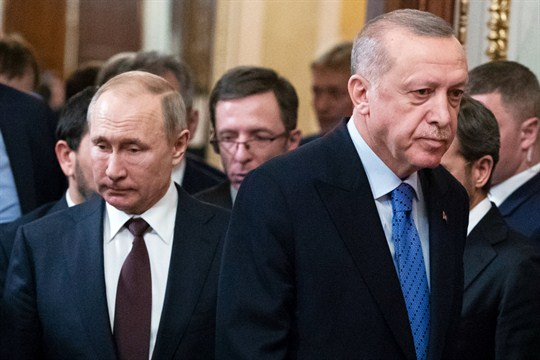 Russian President Vladimir Putin and Turkish President Recep Tayyip Erdogan arrive for a news conference