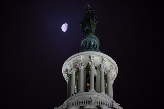 A night-time view of the Statue of Freedom on top of the Capitol Dome in Washington