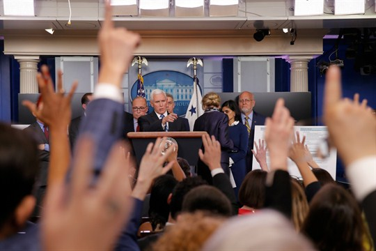 Vice President Mike Pence and other U.S. officials take questions from reporters at the White House.
