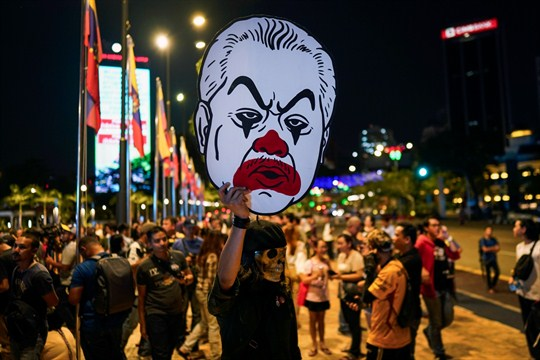 A protester holds a cut-out of new Prime Minister Muhyiddin Yassin during a demonstration.