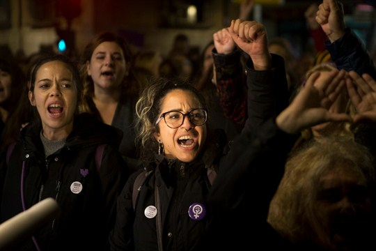 Women protest a new ruling on a sexual assault case in Madrid, Spain