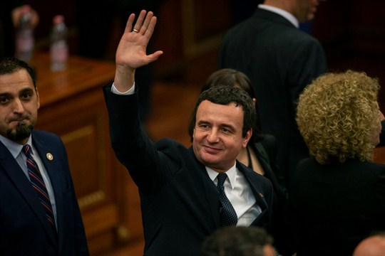 Albin Kurti, the new prime minister of Kosovo, waves after a new government was elected