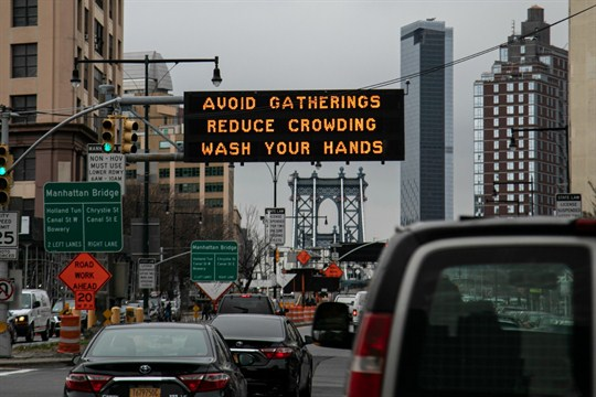 A sign urging commuters to avoid gatherings, reduce crowding and to wash hands, Brooklyn, New York.