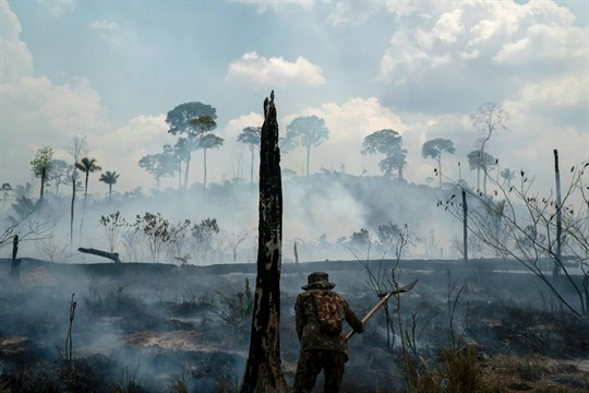 A Brazilian soldier puts out fires at the Nova Fronteira region in Novo Progresso, Brazil.