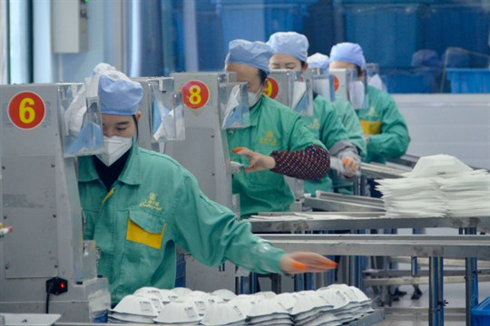 Face masks being manufactured at a factory in Shanghai, China.