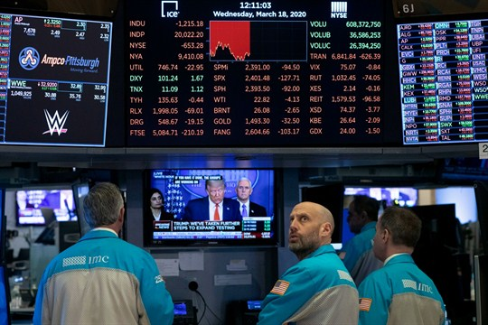 Traders at the New York Stock Exchange watch Trump's televised White House news conference.