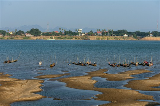 Fishing boats are moored in the Mekong River, in Nakhon Phanom province, Thailand.