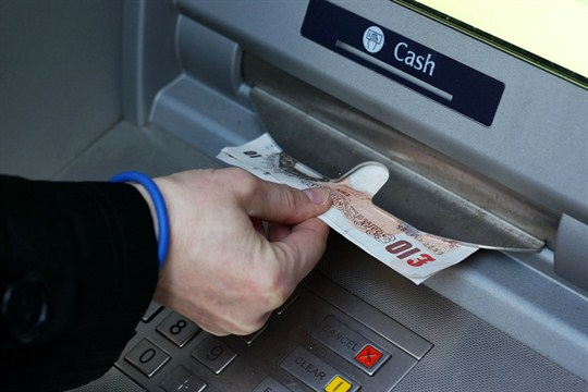 A cash withdrawal at an ATM in Macclesfield, England