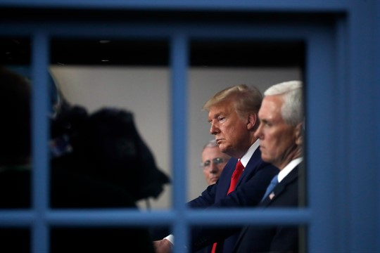 President Donald Trump and Vice President Mike Pence listen to a briefing about the coronavirus