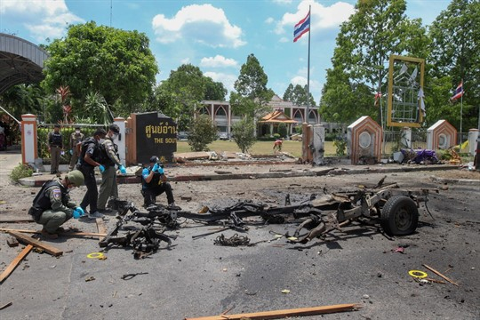 Thai crime scene investigators inspect the site of a bomb explosion in Yala, southern Thailand.