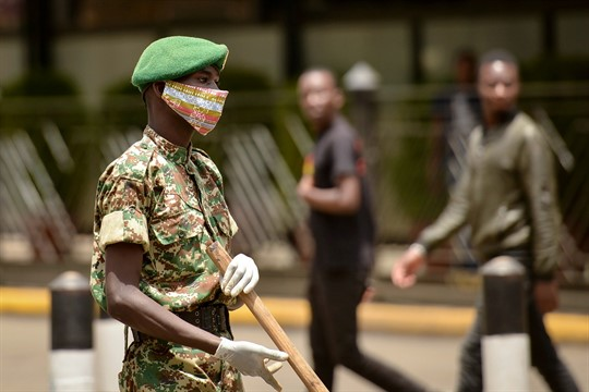 A member of the Kenya Youth Service wearing a cloth face mask