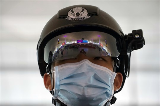 A police officer wearing a face mask at Wuhan Tianhe International Airport in Wuhan, China.