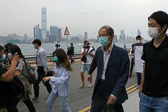 Former pro-democracy lawmaker Martin Lee leaves a police station in Hong Kong.