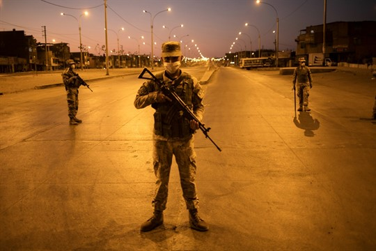 Soldiers stand guard after the start of the curfew in Lima, Peru