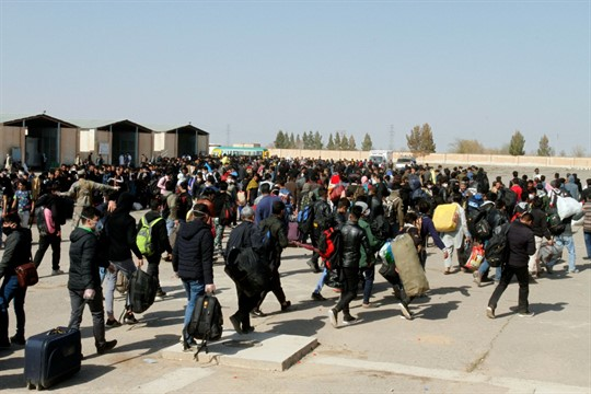 Thousands of Afghan migrants enter Afghanistan at the Islam Qala border crossing with Iran