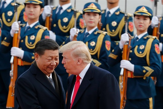 U.S. President Donald Trump chats with Chinese President Xi Jinping in Beijing.