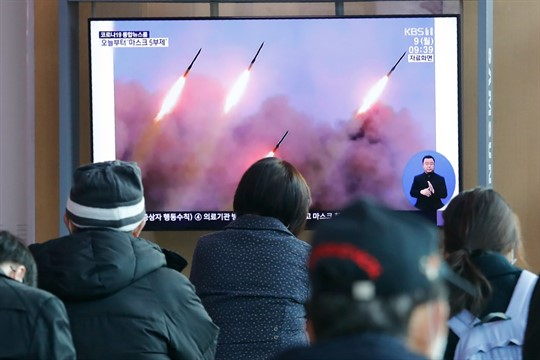 People watch a TV showing images of North Korean missiles during a news program, in Seoul