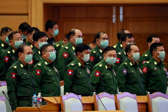 Military representatives war masks during a session of parliament, Naypyidaw, Myanmar.