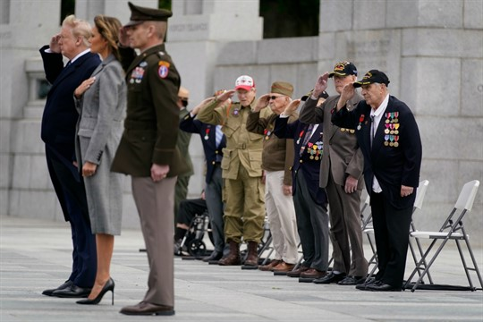 Veterans watch President Donald Trump and First Lady Melania Trump at a World War II commemoration.