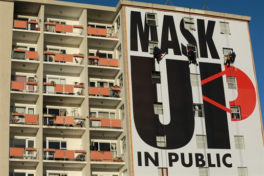 A billboard encouraging people to wear face masks is installed on a building in Cape Town