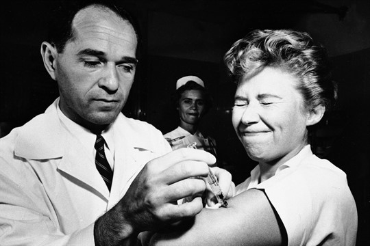 A nurse receives the first H2N2 virus vaccine to be administered in New York in 1957.