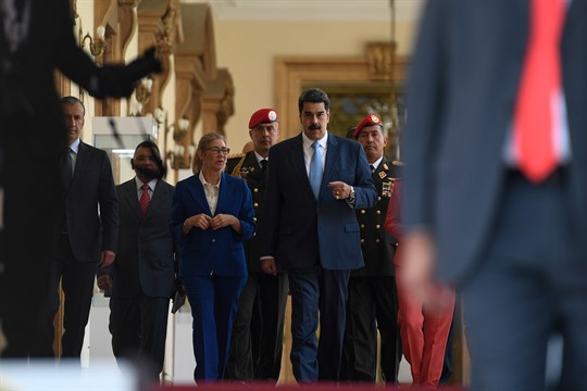 Venezuelan President Nicolas Maduro arrives for a press conference at the Miraflores Presidential Palace in Caracas