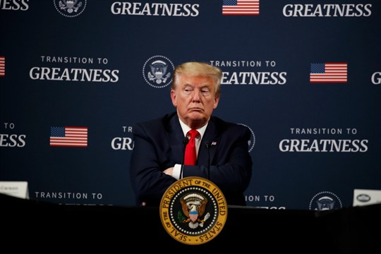 President Donald Trump listens during a session at Ford's Rawsonville Components Plant, Ypsilanti, Michigan