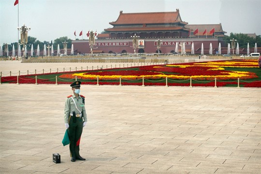 A Chinese paramilitary policeman stands guard at Tiananmen Square