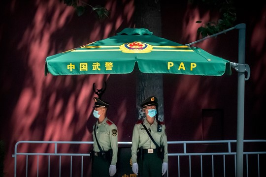 Chinese paramilitary police stand guard near Tiananmen Square and the Great Hall of the People