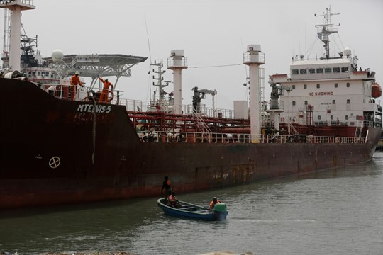 An oil tanker sits at a naval dock yard after being rescued from pirates, Lagos, Nigeria