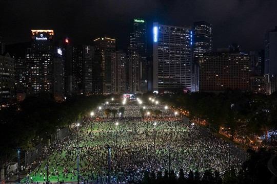 People gather for a vigil to remember the victims of the 1989 Tiananmen Square Massacre