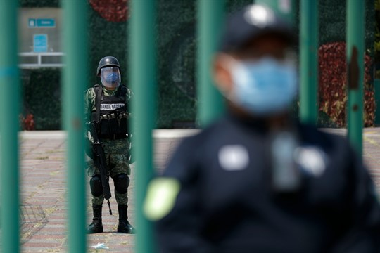 Members of the National Guard and state police stand guard at a hospital in Ecatepec, Mexico