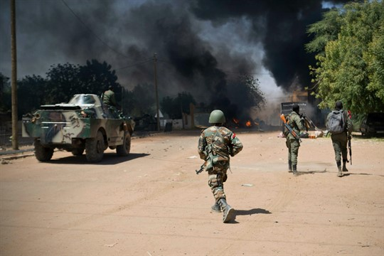 Malian soldiers, working with French forces, battle jihadist insurgents in Gao, Mali