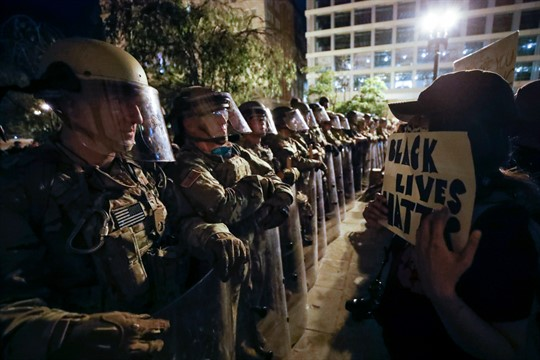 Utah National Guard soldiers face off with demonstrators near the White House