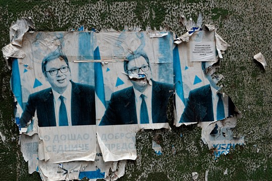 Remains of posters of Serbian President Aleksandar Vucic on a wall in Mitrovica, Kosovo.