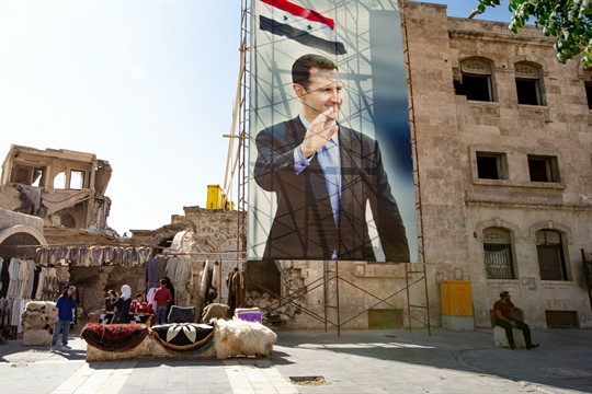 A portrait of Syrian President Bashar al-Assad in the Old City of Aleppo.