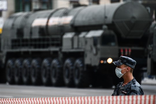 A Russian soldier stands guard near a Yars intercontinental ballistic missile system in central Moscow.