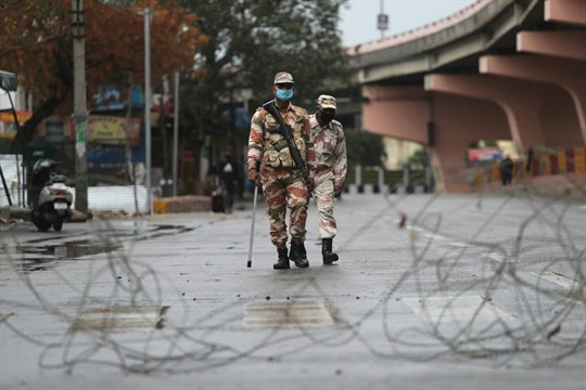 Security officers keep guard during lockdown in Jammu, India