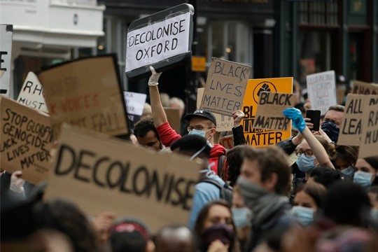 Protesters call for the removal of a statue of Cecil Rhodes, a Victorian imperialist, in Oxford