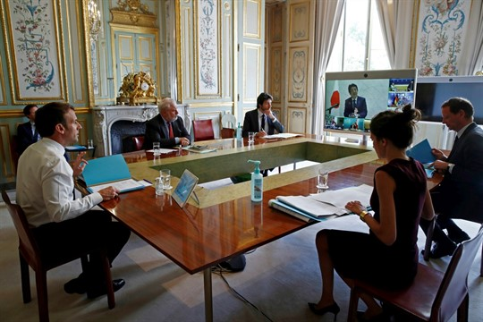 French President Emmanuel Macron speaks with G-7 leaders during a videoconference on the coronavirus pandemic
