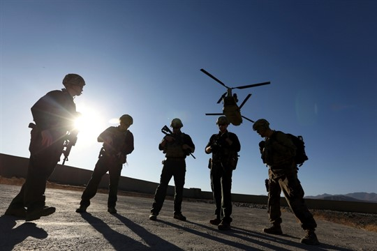 American soldiers wait on the tarmac in Logar province, Afghanistan, Nov. 30, 2017