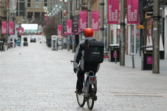 An Uber Eats cyclist during the coronavirus pandemic shutdown in Glasgow, Scotland.