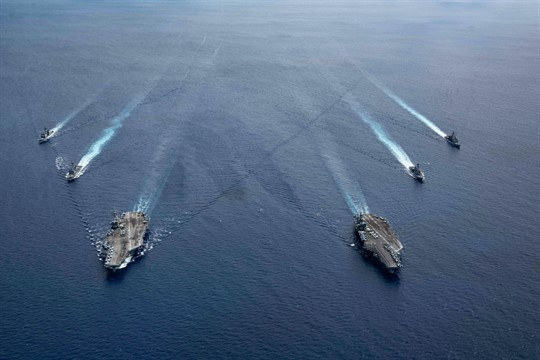 The USS Ronald Reagan and USS Nimitz Carrier Strike Groups in the South China Sea