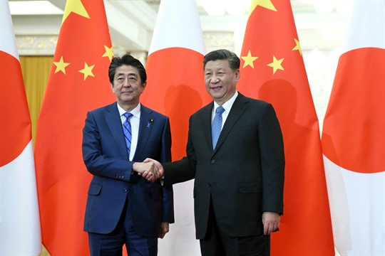 Japanese Prime Minister Abe Shinzo and China's leader, Xi Jinping, in Beijing.