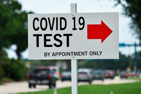 A sign directs people to a COVID-19 testing center in Port St. Lucie, Florida, June 2020