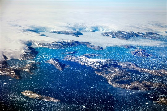 Icebergs float in a fjord after calving off from glaciers on the Greenland ice sheet
