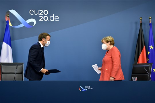 German Chancellor Angela Merkel and French President Emmanuel Macron prepare to address the media in Brussels